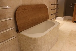 We created a bespoke storage area with a hinged oak lid for towels.