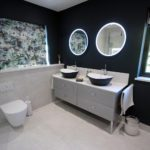 3. A stunning double basin. Glass fronted furniture with a solid surface worktop.