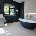 7. Either side of the bath is a bespoke recessed mirror cabinet.
