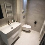 1. A small guest en-suite. Featuring the Laufen Val 750W washbasin with double drawer vanity.