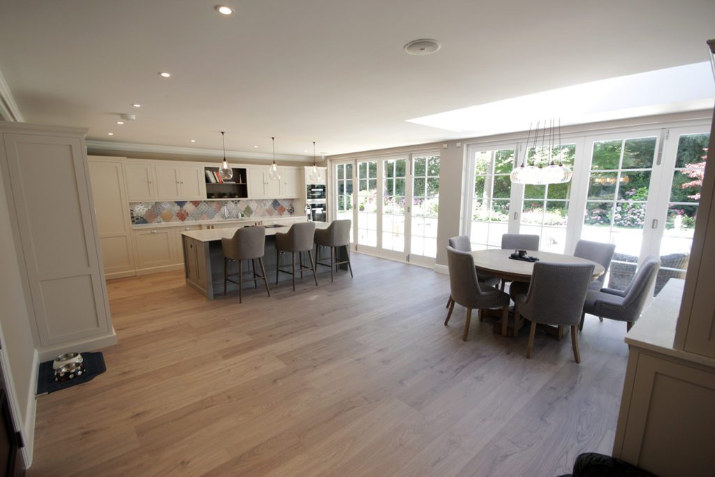 1. A vast space showcasing the full kitchen dining space.