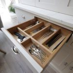 23. Solid oak drawer boxes with bespoke cutlery insert.