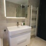 5. Laufen Val 750W ceramic washbasin. LED lit mirror cabinet with heated doors and internal shaver socket.