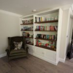 1. We made a simple open bookshelf unit with double door storage below. We love the warmth of the walnut shelving.