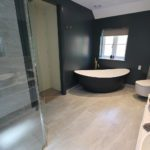 10. This master en-suite has it all. Breeze bath from Waters Baths of Ashbourne, painted in Farrow & Ball Hague Blue.