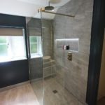 14. Brushed brass shower from JTP. Shower glass and fittings from Kudos.