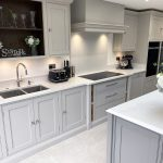 The handmade cabinetry on the island is finished in Farrow & Ball Worsted and the perimeter cabinetry in Farrow & Ball Cornforth white.