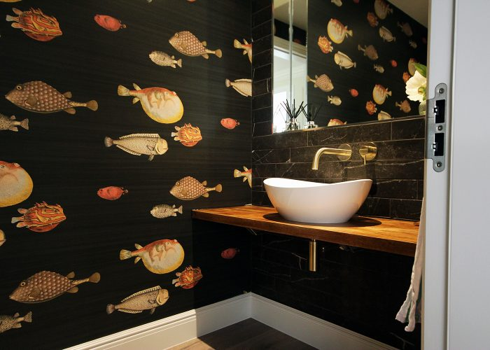 1. A beautiful cloakroom featuring Acquario wallpaper from Cole & Son.