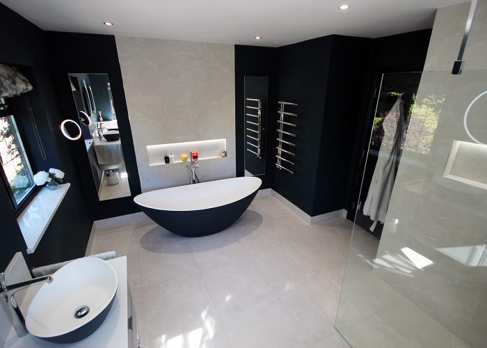 1. A beautiful large master en-suite. Painted in Farrow & Ball Hague Blue. Tiled in Minoli Moon Onyx.