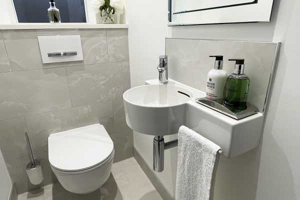 3. Laufen Pro rimless wall hung WC with Geberit concealed frame and cistern.