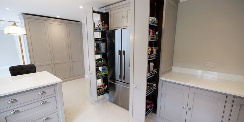A huge amount of storage is gained through the use of pull out larder storage – a modern solution in a classic styled kitchen.