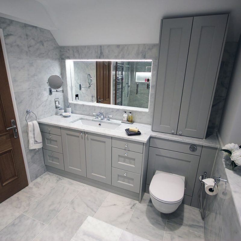 1 - A gorgeous classic contemporary bathroom. Tiled in our premium smoked Carrara marble, which is more subtle/cloudy compared to traditional Carrara. Bespoke fitted furniture painted in Farrow & Ball Pavilion Gray.
